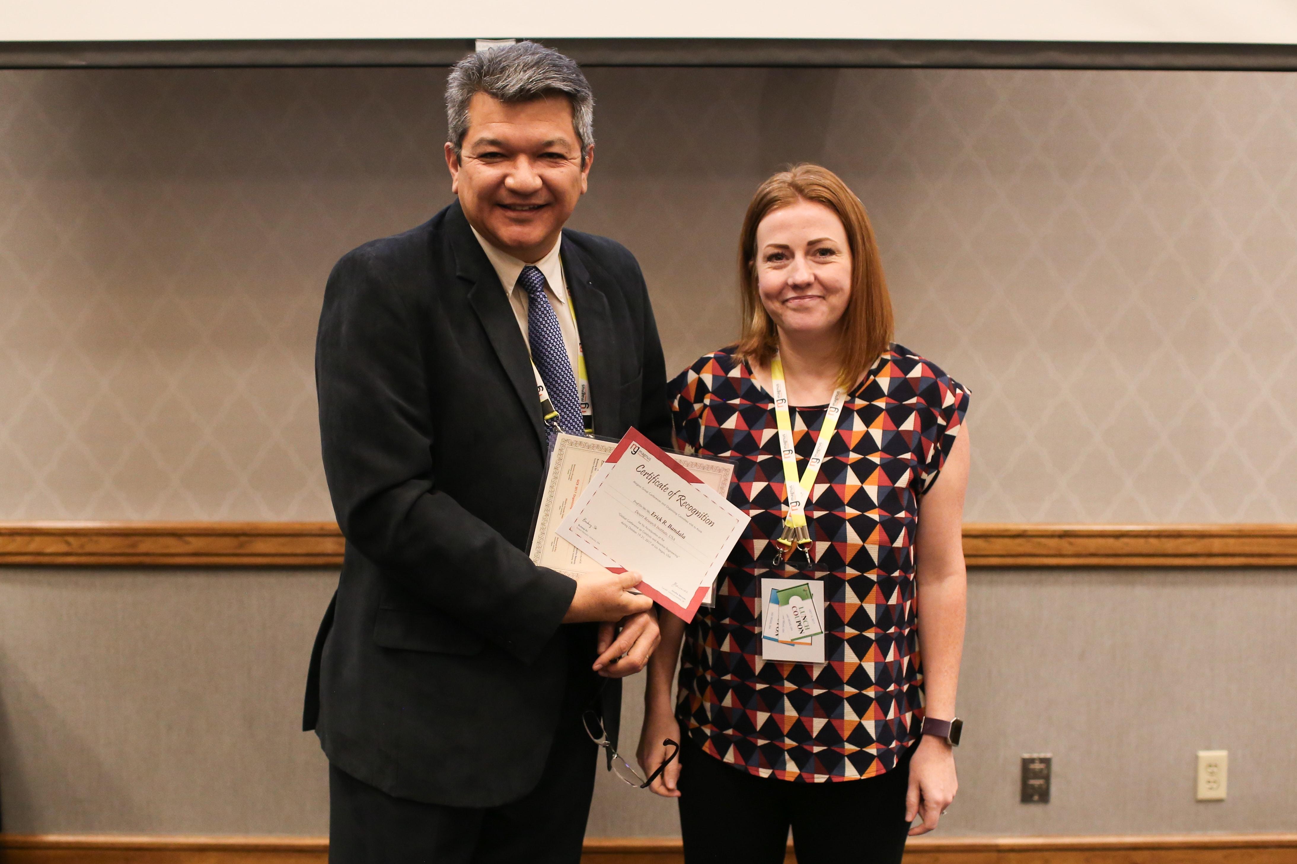 Erick R. Bandala felicitated by Jennifer Edwards