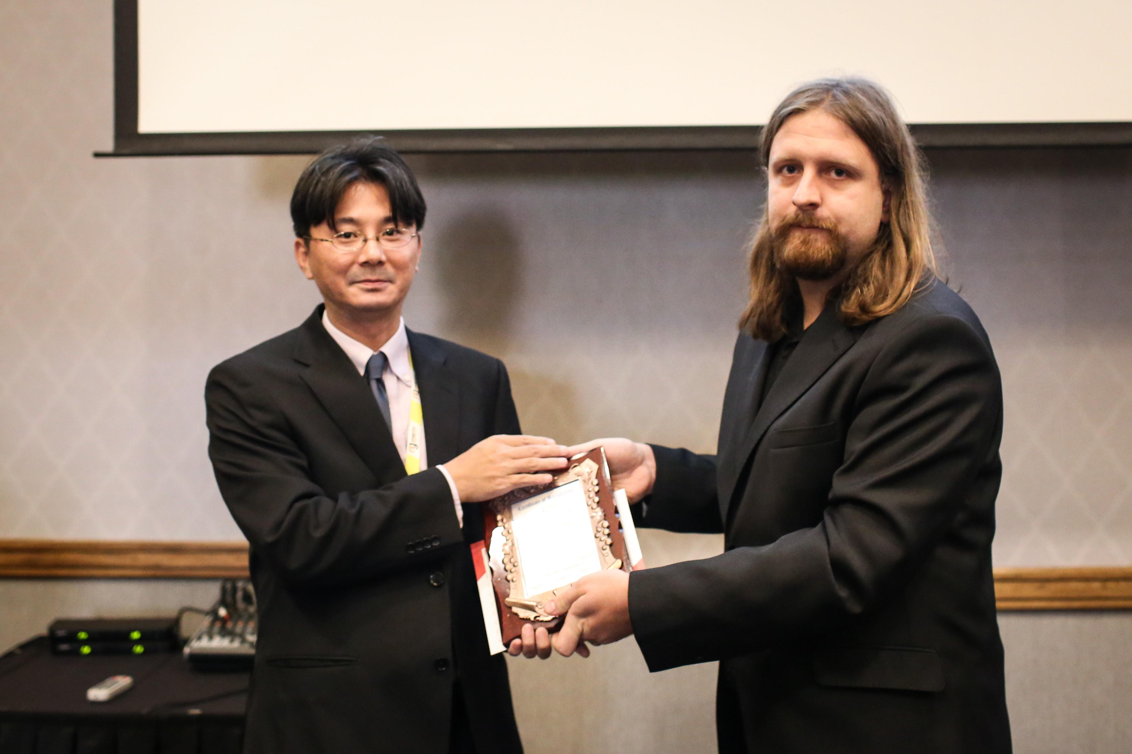 Kenichi Komura felicitated by Jiri Tuma