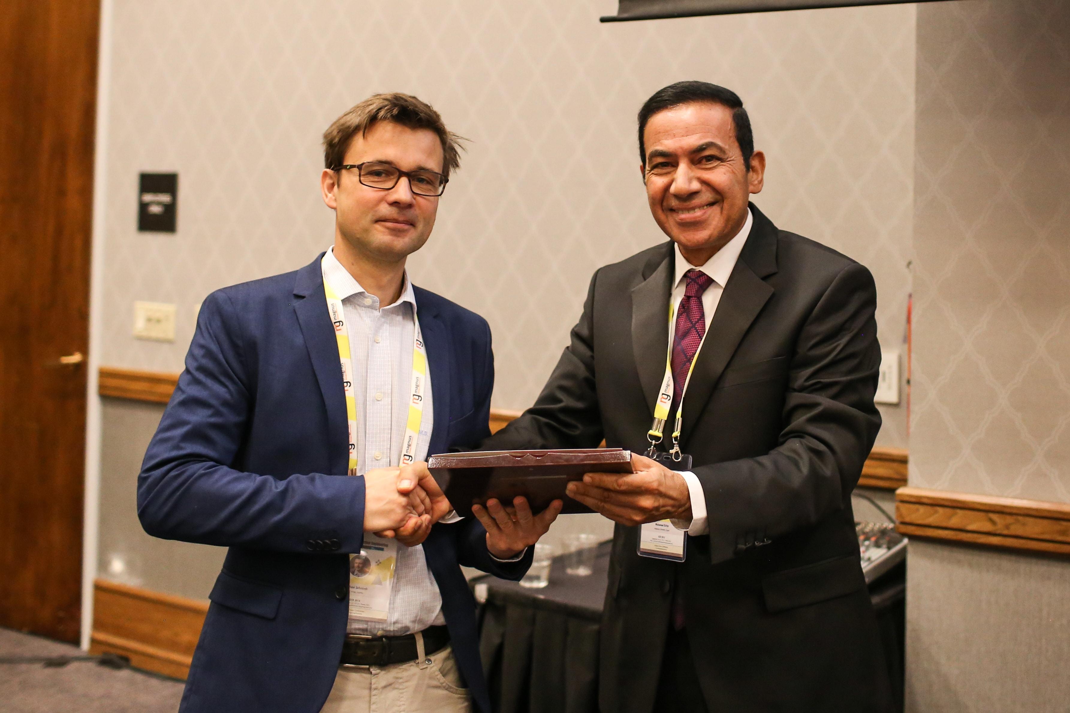 Michael Schnurch felicitated by Mohamed El-Far